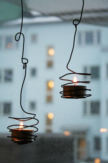 Make stylish tea light holders from nothing but wire  Want to add some style to an indoor or outdoor living space on the cheap? All you need is a roll of wire and some pliers. I stumbled across this DIY tea light holder idea from Remodelista via Pinterest the other day. It reminds me a lot of this very chic (and popular) hanging candle holder made from a wine bottle.