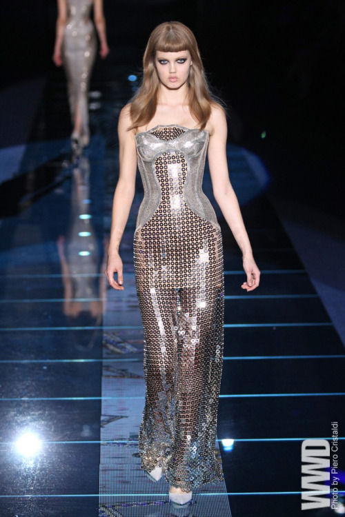womensweardaily:  Versace RTW Fall 2012 With their bangs bluntly razored an inch beneath the hairline, eyebrows  bleached and cheekbones lit like knives, the models in the Versace show  looked like the kind of girls you find at ease in a nameless afterhours  club — or in an Oscar-nominated performance by Rooney Mara. And that was  just from the neck up. Below, the clothes were all gothic drama and  underground kink, as Donatella Versace turned on the dark for fall. Not  even her high glamour gloss of crystals and articulated curves (both  here in spades) could file down the edge.