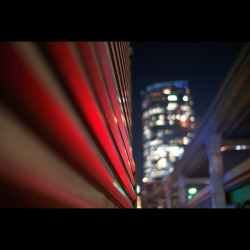 02/23/2012: The View of Mori Tower from the Nishi-Azabu Intersection#creative366project on Flickr.The doctor checked the last wound they had long been worrying about, and he decided it was OK enough for me to leave the hospital :)))))) Yay!!!!! So this Sunday, I'll go home. I've been here for 62 days … It is too long. After the check, I took a happy walk. It was my first stroll in the evening since I got hospitalized. The object seen on the left is a wall of a restaurant. The red light was coming from the cars on the street. The elevated expressway seen on the left is Metropolitan Expressway Route 3 (No. 3) which appears in 1Q84. The building in the distance is the Mori Tower of Roppongi Hills. If I had a tripod, I would have shot the view differently, but with the Nokton, I liked it this way. #elevatedexpressways Camera: Panasonic Lumix DMC-GH2 Lens: Voigtländer Cosina Nokton 25mm f/0.95
