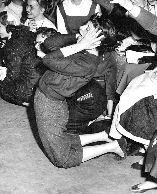 A fan goes crazy at a Pat Boone concert, 1956.
