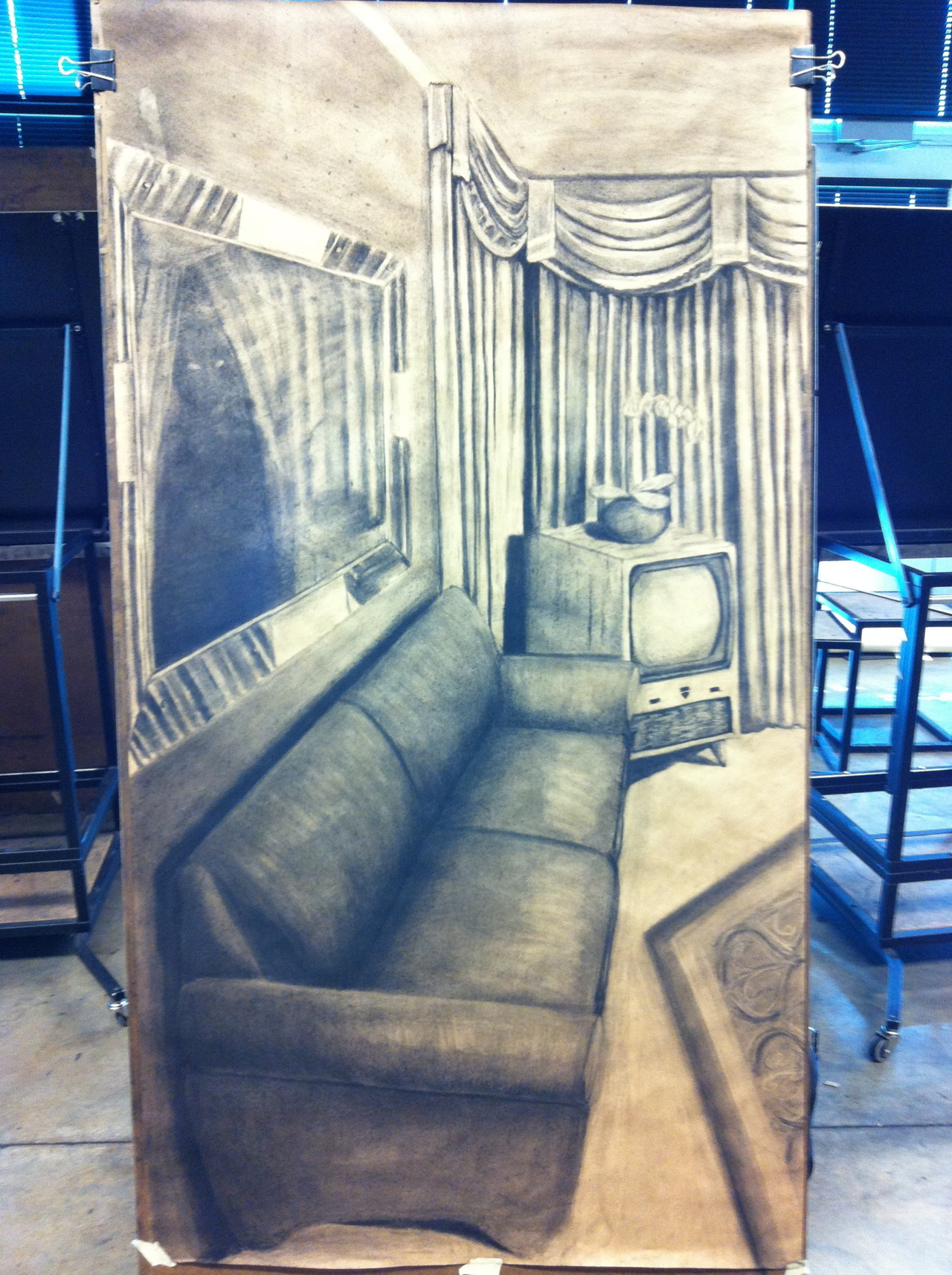 A super large piece I did in my Drawing 1 class. We had to do a room that showed some spatial depth and I really wanted to do a motel. I think it turned out pretty good. I may even enter it in the Art show later. Done in charcoal, which I have a love/hate relationship with.