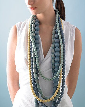 Dyed Wooden Beads Necklace | Martha Stewart These beads piled en-masse are so pretty! They have a soft, beachy feel to them, perfect with a white summer dress. I've been thinking of doing some dyeing but dye is so expensive that I want to make sure I get as much use out of it as possible!
