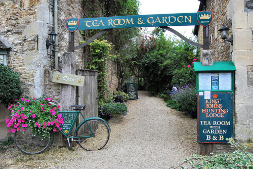 bewitchingbritain:    Tea room with garden and a blooming bicycle in Lacock village of Wiltshire, England; a film and TV favourite notable for its picturesque streets and historic cottages. The village appears in the BBC's Pride and Prejudice and Cranford; as well as the Harry Potter films The Philosopher's Stone and Half-Blood Prince. Lacock is laid out in a traditional medieval grid pattern, so unless you are me you are assured you will not get lost. (image kev747 on flickr; he also has a tumblr here)  This is possibly the most English photograph in the world.