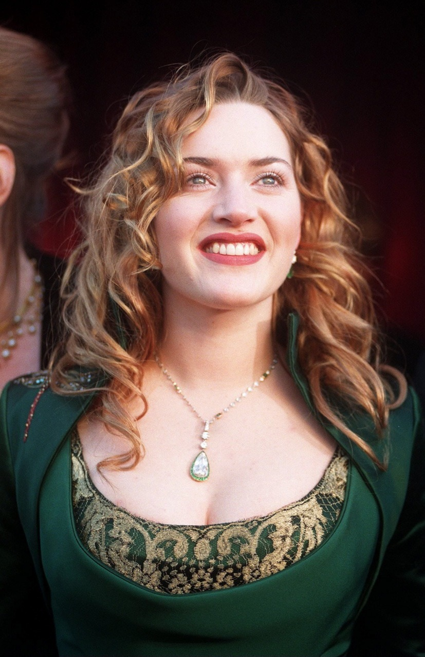 Kate Winslet - Oscars, March 23rd 1998 Look at sweet young Kate! Kate was nominated this year for her role in Titanic, already her 2nd Oscar nomination! Years later & I'm only just discovering that apparently this Givenchy by Alexander McQueen gown that has made me so happy for over a decade was not celebrated & made an appearance on many a-worst dressed list. It's cemented in my brain as an important part of Oscar history though because Kate is so curvy, so fantastically busty, so ethereal with her green & gold gown & romantic red curls. I am forever smitten.