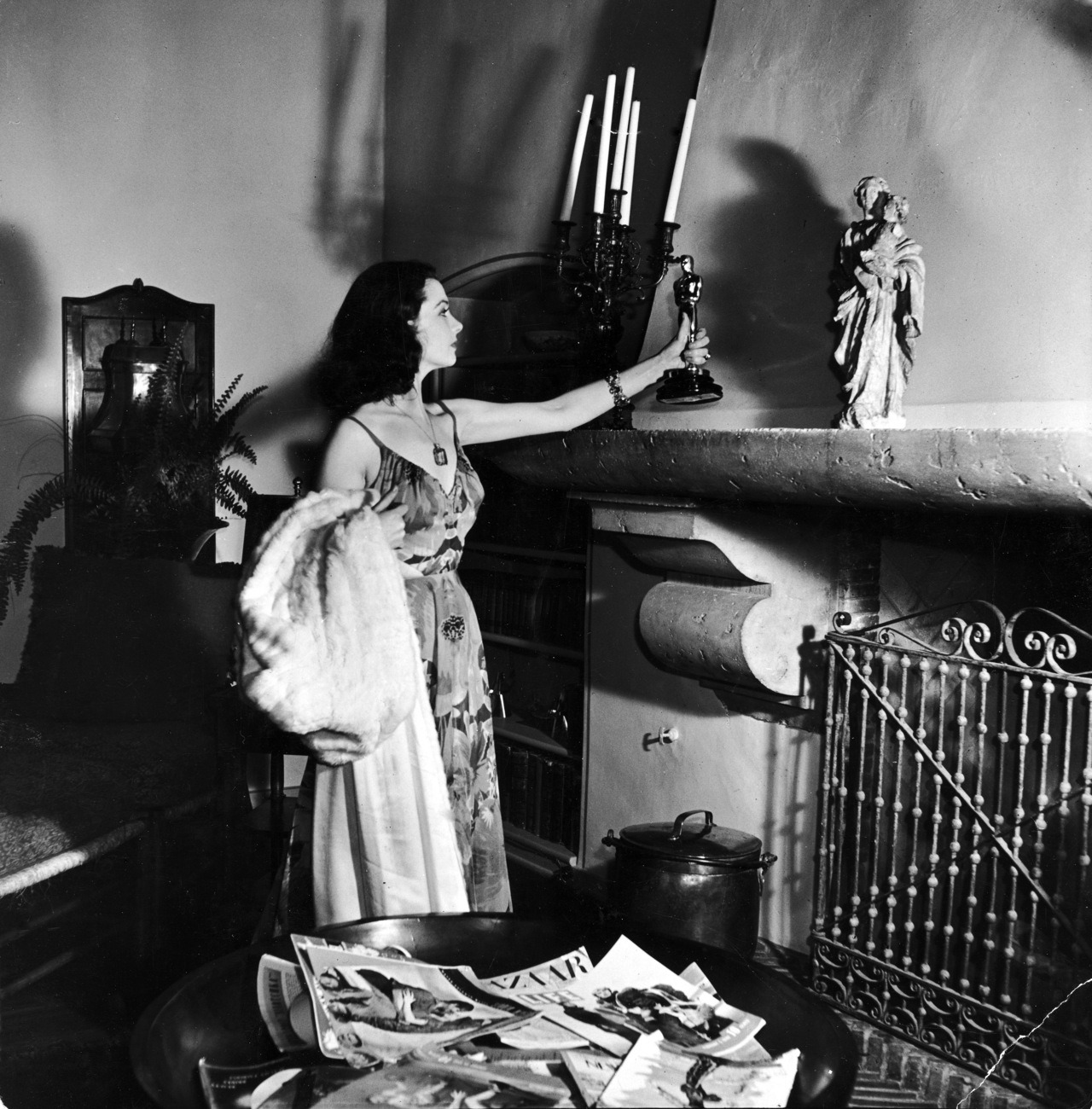 Vivien Leigh placing her Best Actress Academy Award on her mantel the morning after the Oscars.  She won for her role as Scarlett O'Hara in Gone with the Wind in 1940, the first year the ceremony was televised.