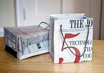"thingsrecycledusefully:  How to make gift bags from newspaper When I bought something at a store recently, the clerk handed me my purchase in a bag made from a newspaper. I liked it very much and had to make some more—thus today's DIY recycled newspaper project: gift bags made from the Wall Street Journal. You can vary the dimensions, of course, but here's what I used to create a bag that's 5"" tall, 4.5"" wide, and 3"" deep. via:  guatemaloso"