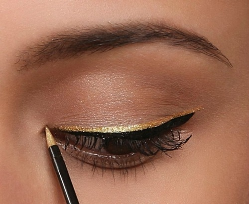 Gold eyeliner always reminds me of Cinna now..