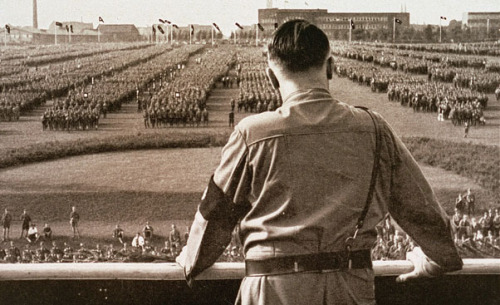 """Adolf Hitler addresses a rally of the SA (Sturmabteilung - paramilitary stormtroopers). North Rhine-Westphalia, 1933."" Source."