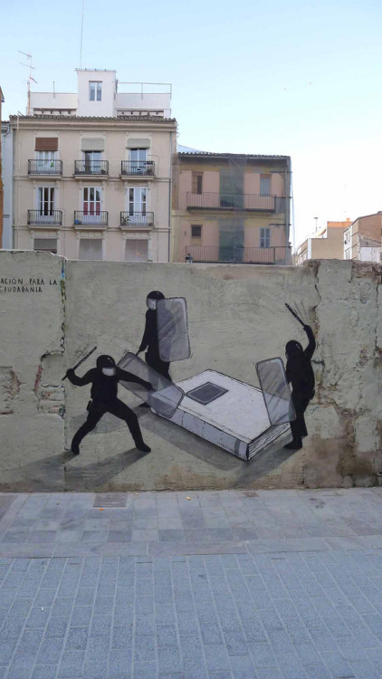 darksilenceinsuburbia:  Escif. Educación para la ciudadania. Valencia, Spain. You can see this work also at http://paxmachina.co/ , visit and read the story about this Escif piece.