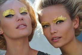 Who needs eye shadow? Not Fendi anyway. For their Spring Summer 2012 collection, lids were adorned with gold leaf as opposed to a more generic or traditional powder. Maybe at first glance it looks a little clunky and awkward but the more you look the more you love. There is no denying this eye catching and brightening step on Fendi's part. And besides, who doesn't want to wear gold?
