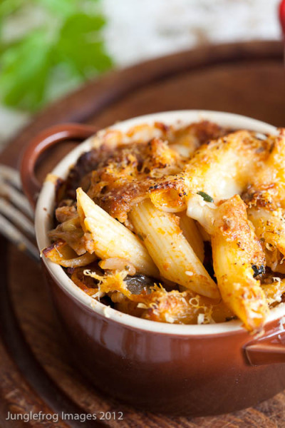 Baked penne with eggplant, tomatoes and cheese