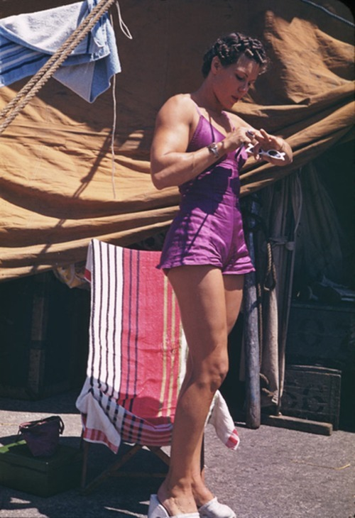 calumet412:  A John Cushman Kodachrome of a circus trapeze artist, taken at Soldier's Field, c.1944, Chicago. Those arms!  wow. i'm in awe.