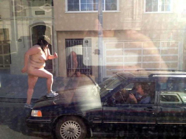 "laughingsquid:  Large Naked Woman Stomps On Car In Noe Valley in San Francisco   ""all of us, we're going out tonight. We're gonna walk all over your cars!"""