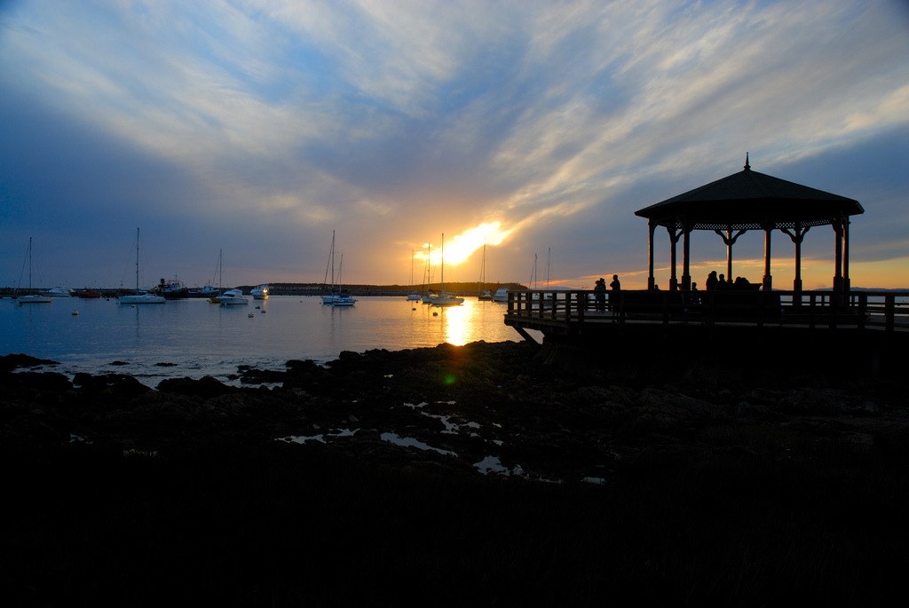 People enjoying the sunset while overlooking the harbor of Punta del Este.