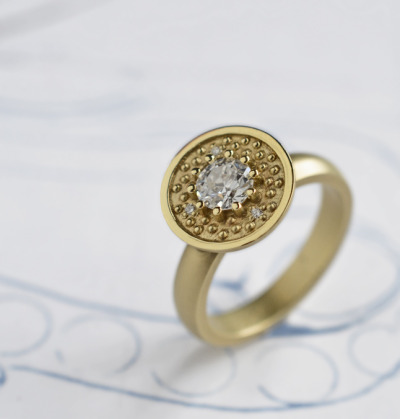 J's orb 377 style with an Old European cut diamond in 14k green gold