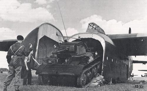 talesofwar:  A British Tetrach light tank just squeezed inside the huge Hamilcar glider. A glider…with no propeller to get this thing flying. It is amazing.