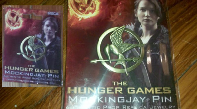 chroniclesofpanem:  MOCKINGJAY PIN GIVEAWAY! [sorry about the glare but i am just too dang lazy to take another picture. hahahaha.] So, a while ago, I promised that if this post got to 10,000 notes, I'd do a giveaway. Since it has long since passed ten thousand notes, it's about time I made good on my promise! Terms and Conditions…the kind you'd want to read: You don't have to be following me, but it would be rather nice of you if you did. (: No reblogs from tumblogs please. I want this to be fair.  Both likes and reblogs count.  5 reblog maximum.  I can ship anywhere on the whole entire planet. Anywhere…as long as you have an address. The winner will be chosen on March 23 (har harr, see what I did there?) at noon EST. I think that's all the rules.  The pin is made of metal and is officially distributed by the NECA. Copyright, Suzanne Collins and Lionsgate Films Inc.  And even though it's beyond cliche: may the odds be ever in your favor! (: