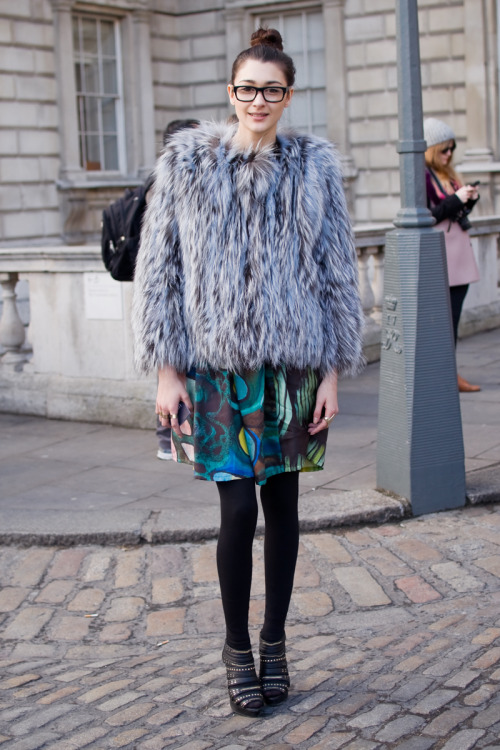 Model Emily Brooks wearing a Lulu Liu coat and skirt, with shoes from Topshop, at London Fashion Week. Photo by: Martin Isaac