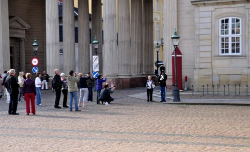 Copenhagen, guards and tourists outside Amalienborg Castle