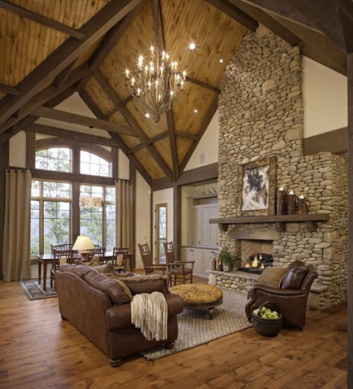 Rustic living room of stone and wood with an unusual multi-vault ceiling (via Johnson Architecture)