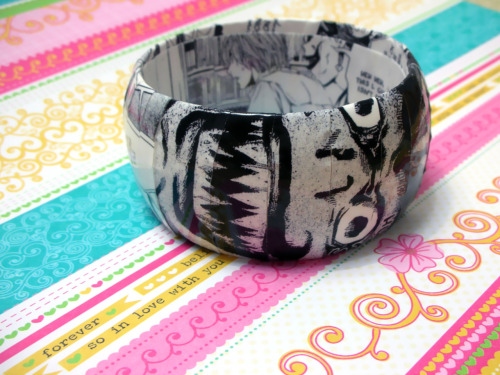 Here's another Death Note manga bracelet!  This one features Light Yagami and Shinigami Ryuk as they confront L on TV.  It's a dome shaped bracelet and it'll fit mostly small to medium size wrists.  Available here <3 http://www.etsy.com/listing/93884898/death-note-manga-bracelet-featuring
