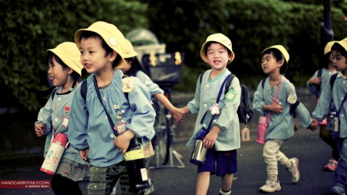 Children out on excursion | Ueno, Tokyo 2011 With a skip in their step and hands joined, a rowdy rabble of school children in yellow hats passed by, on their way to Ueno Zoo, their teacher at the back like a shepherd watching over his flock of noisy sheep. See the rest of my photos from Japan!