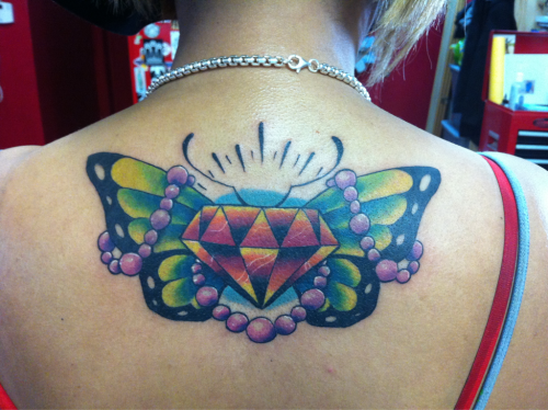 Butterfly diamond with pearls Tattooed by Aaron Trimiar.