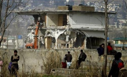 "shortformblog:  Osama bin Laden's compound currently getting destroyed: The place where the al-Qaeda leader spent his final days is getting razed in what appears to be a surprise demolition. Not that locals are complaining: ""We were searched and questioned every time we wanted to reach our homes,"" said 22-year-old college student Shabbir Ahmed, who lives in Abbottabad. ""When this symbol of evil is finally gone, people in the area will be able to rest."" Last year's raid angered the Pakistani government, who were not told that it was going to take place by the U.S. government, who feared that an official would tip off the figurehead. (ht idroolinmysleep; photo by Anjum Naveed/AP)"