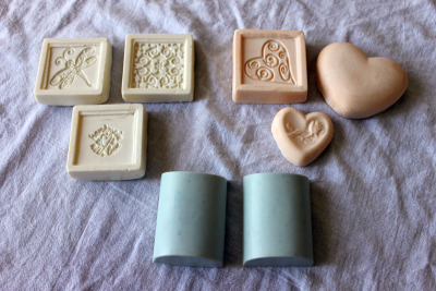 My first batch of homemade soaps! These are made with olive oil and canola oil.  The white ones are not scented, peach is vanilla, and light blue is lavender.  They smell amazing!  Now to wait 4-6 weeks before trying them out! Can't wait!