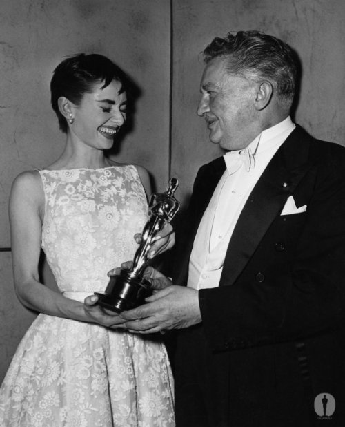 "Audrey Hepburn won for ""Roman Holiday"", with Jean Hersholt at the 26th Academy Awards"