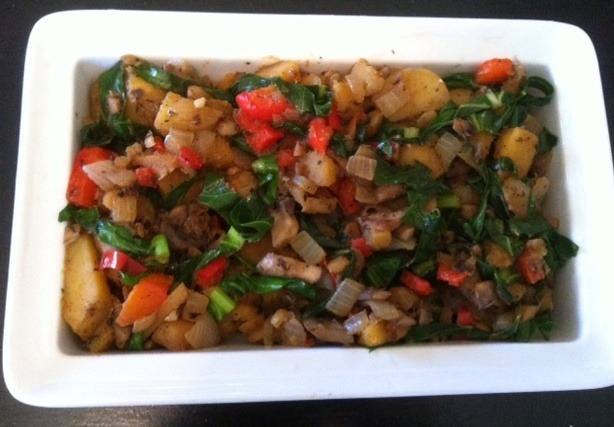 Winter Vegetable Hash 1 tbs extra virgin olive oil 1 lb. Yukon Gold potatoes, diced1 C mushrooms, diced 1 red bell pepper, diced 1 small acorn squash, diced 1 small yellow onion, finely chopped 2 garlic cloves, minced 1 pinch salt 1 pinch ground black pepper 1C collard greens, sliced into ribbons 1tsp dried thyme Place oil in a large skillet over medium heat. Begin to cook potatoes and squash for about 10 minutes until they begin to get soft.  Add the bell pepper, onion, mushrooms and garlic. Season with salt and pepper.   Cook for another 10 minutes or until the potatoes and squash are beginning to brown a bit.   Mix in the collards and the thyme. Continue cooking for 5 minutes, until the collards have wilted. Serve immediately. Video cooking demo of this recipe.