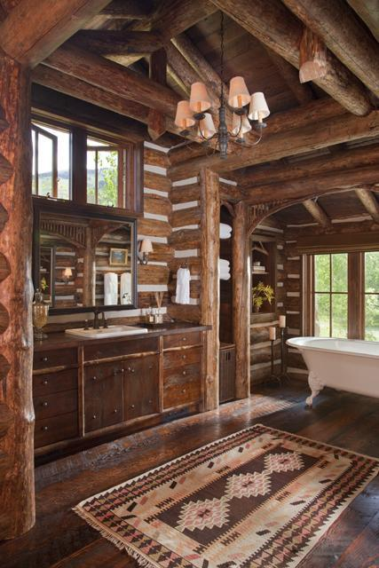 Beautiful and rustic log home bathroom with an abundance of warm-toned wood (via 360 Ranch - Main Lodge - Architect Portfolio | Miller Architects)