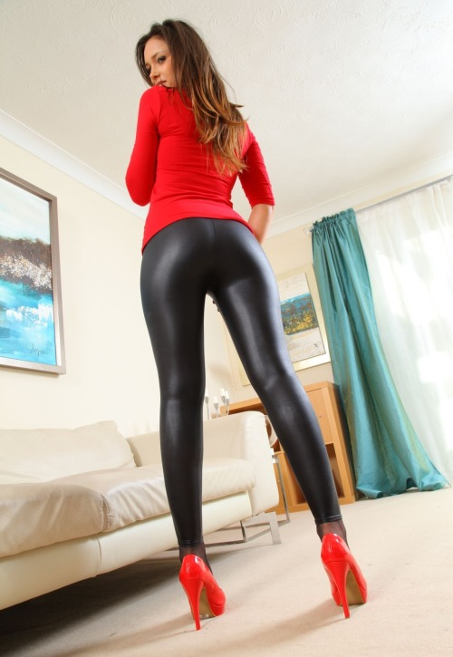 cocks-n-cunts:  Love those leggings  Her leggings are awesome - and her heels are so sexy. Great color coordination. All she needs is a slut on his knees face pressed to her ass (pick me please!) to complete the picture.