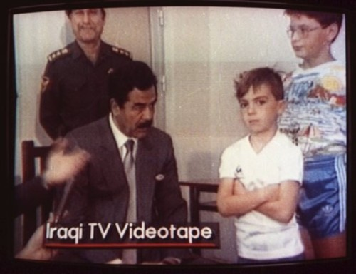 dukeofpolyopoly:  British citizen Stuart Lockwood, refusing to sit on Saddam Hussein's lap during the Gulf War.