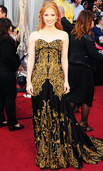 Jessica Chastain in a chiffon Alexander McQueen gown with baroque details at the 2012 Oscars.  She's nominated for Best Supporting Actress