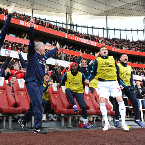 Arsenal bench celebrate Robin van Persie's goal