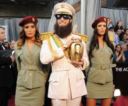 Sacha Baron Cohen arrives at the Oscars.