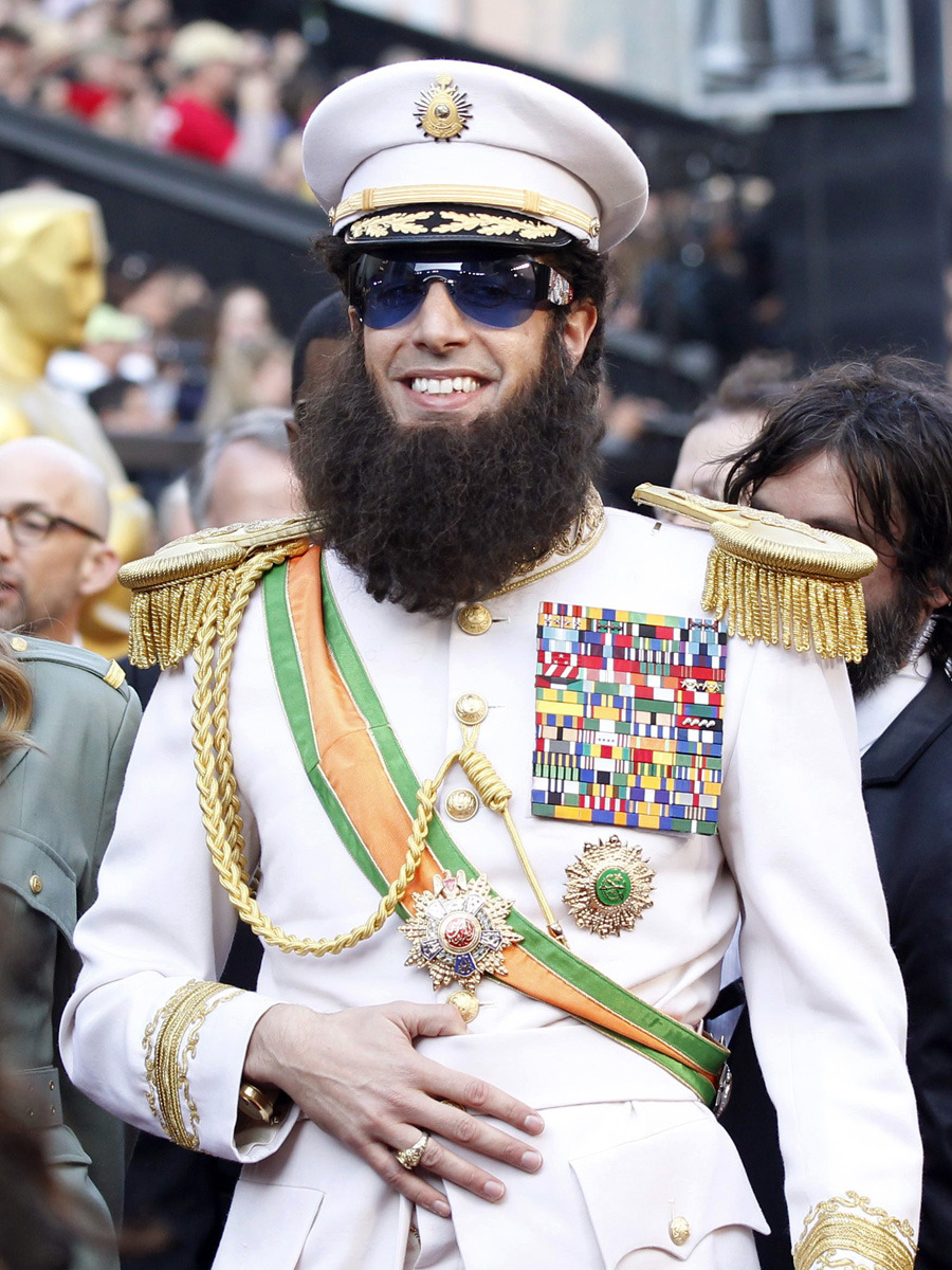 "nparts:  Sacha Baron Cohen, dressed in character from his new film ""The Dictator"", arrives at the 84th Academy Awards in Hollywood, California February 26, 2012. (REUTERS/Mario Anzuoni)Related:Live Chat: The 2012 Academy Awards Photo Gallery: The 2012 Academy Awards"