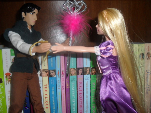 Reluctantly, Flynn hands Rapunzel her crown back. Pretty princess time is over.