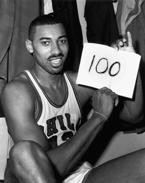 "On this day in 1962, Philadelphia Warriors center Wilt Chamberlain scored 100 points in a 169-147 win over the New York Knicks in Hershey, Pennsylvania. Widely considered one of the greatest personal records in all of sports, Chamberlain's feat was not televised and no video footage of the game exists. ""True, over-anxiousness caused Wilt to miss some shots he'd ordinarily make. But he made some he wouldn't have dared taken under ordinary circumstances. Long jumpers from 25–30 feet out with two and three men clinging onto the wiry, 260-pound frame. Power-packed dunk shots when he had to bull through, around and over a tight knot of defenders. Blazing speed that carried him downcourt for layups after he had launched the fast break with a rebound himself. He earned every point."" —Jack Kiser, The Philadelphia Enquirer"