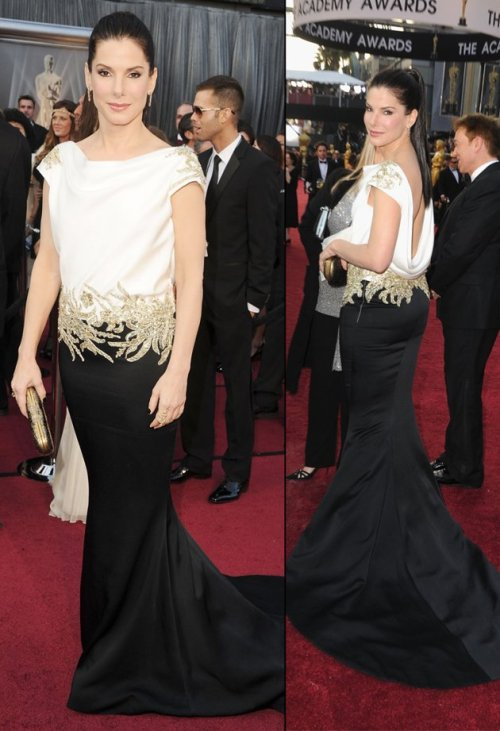 Great back shot of Sandra Bullock's dress. I'm in the minority but I love it! omgthatdress:  If the top of Sandra Bullock's dress fit better, she'd look a lot better.  But I like the uniqueness of this dress!