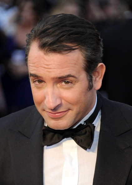 ikeep-holding-onto-nothing:  Jean Dujardin making ovaries explode at the 84th Annual Academy Awards  My poor couch, with bits of my ovaries all over it! It'll never be the same!