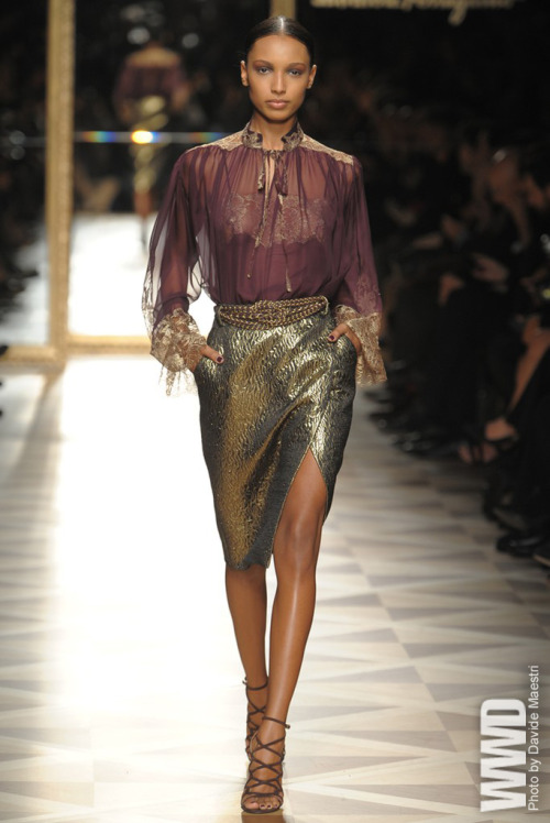 Salvatore Ferragamo RTW Fall 2012 Czarist Russia. The gilded life of the elite few guided Salvatore  Ferragamo  creative director Massimiliano Giornetti for fall, with  strong results. In the  elegant lineup, the designer took the theme on  from two perspectives: the  strictness of military silhouettes and the  soft romance associated with Eastern  Europe of those prerevolution  years. Often, Giornetti combined the two, such as  in an appealing  structured gray military coat teamed with an ultrafeminine  paisley  dress.