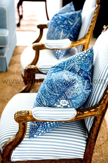 Beautiful white and blue chairs and cushions.