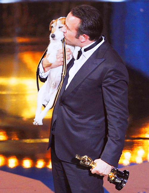"Best Actor winner Jean Dujardin kisses Uggie the dog after ""The Artist"" won the for Best Picture at the 84th Academy Awards in Hollywood, California, February 26, 2012."