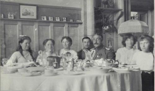ohsoromanov:  Maria,Alix,Olga,two unidentified gentleman,Tatiana and Anastasia.  When or where? Also, can anyone identify the two gentlemen? I want to say sometime around 1914, due to Tatiana's hair, I'll just caption it that.