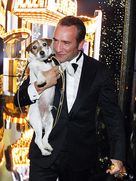 Best Actor winner Jean Dujardin and his costar, Uggie.   I love them!!! my 2 fav actors :-)