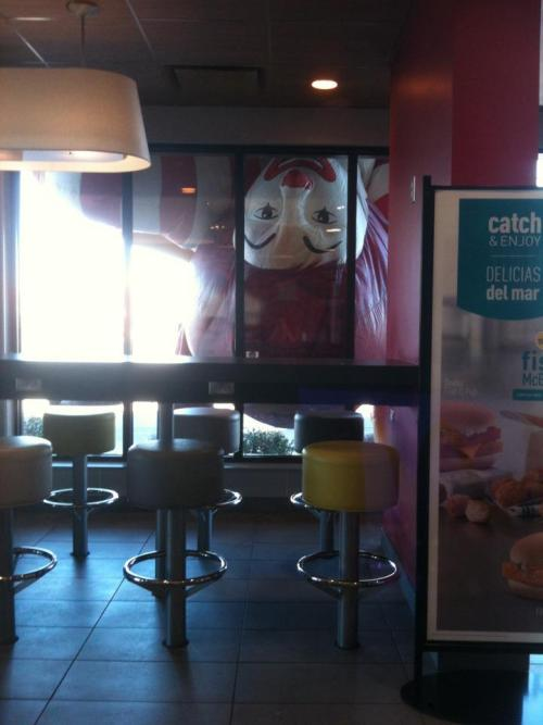 Ronald MC Donald is watching you while you eat..