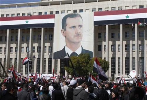 reuters:  Around 89 percent of Syrians approved a new constitution, proposed by President Bashar al-Assad, in a referendum on Sunday, state television said on Monday. Constitutional reforms are aimed at quelling the growing rebellion against the Assad family's 42 years in power, but Assad's opponents and the West have the dismissed the reforms and the referendum as a sham. Turnout in the referendum was 57.4 percent, state television said. Live blog: The conflict in Syria - latest news, photos and videosLatest story: New Syria constitution wins 89.4 percent approval - report  Will Assad use this as an excuse to continue the anti-rebel crackdown? Seems like it so far.