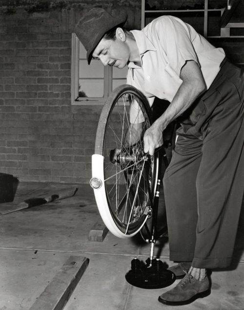William Powell fixes a bike.